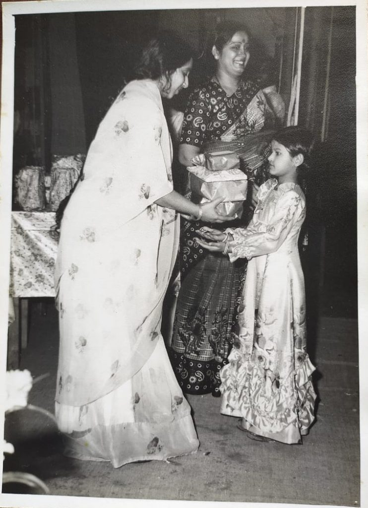 Shilpi holding prizes at age 5